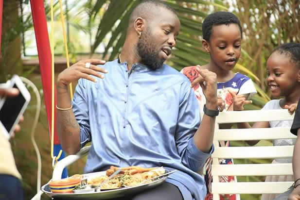 Eddy Kenzo with his daughters